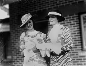 Miss G. Griffin and Miss N. Beasley studying the form guide at the Brisbane races 1934