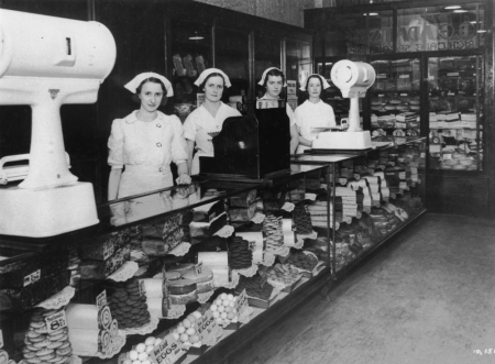 Shop assistants inside George Adams cake shop ca. 1938