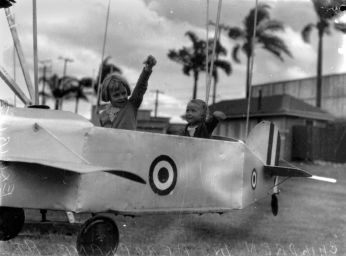Children enjoying an aeroplane ride at the Exhibition Brisbane 1938